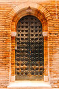 Fragment of red vintage old brick wall with door Royalty Free Stock Photo