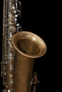 Fragment of the saxophone a vintage on black background Royalty Free Stock Photos