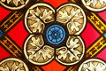 A fragment of stained glass. Fragment of colored ornamental glass of window of the church. Royalty Free Stock Photo