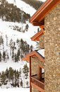 Fragment of the stone house at a mountain slope in the winter Royalty Free Stock Photo