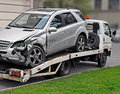 Fragment of tow truck which is taking away faulty car old from place accident in repair insured event Stock Photography