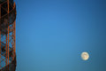 Fragment of tower against evening sky with moon Royalty Free Stock Photo