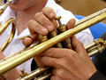 Fragment of trumpet with hands musician Stock Images