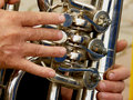 Fragment of tuba with hands musician Royalty Free Stock Photos