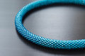 Fragment of a turquoise necklace on a wooden background close up Stock Photo