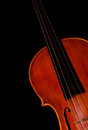 Fragment of a violin on black background Stock Photography