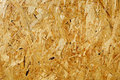 Fragment of wooden fibreboard panel surface Royalty Free Stock Photo