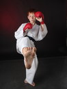 A fragment of a workout teenager karate blue belt works off technique an attack while wearing gloves Royalty Free Stock Images