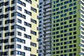 Fragments of high-rise buildings with windows and balconies close-up Royalty Free Stock Photo