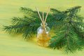Fragrance coniferous sticks or scent diffuser bottle with sprig fir on wooden background Stock Images