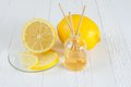 Fragrance lemon sticks or scent diffuser bottle with on wooden background Royalty Free Stock Photo