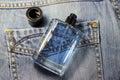 Fragrance for men on the background of denim soft focus Stock Photos
