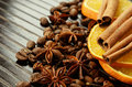 Fragrant spices with dry oranges and coffee on a dark striped background Royalty Free Stock Photo