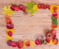 Frame of autumn leaves with apple on a wooden brown background Royalty Free Stock Photo