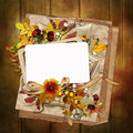 Frame with autumn leaves and berries on wooden background old paper Royalty Free Stock Photo