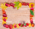 Frame of autumn leaves on a wooden brown background Royalty Free Stock Photo