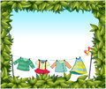 A frame border with hanging clothes and a bird illustration of Stock Photo