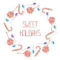 A frame border wreath with the watercolor striped red white lollipop and candy cane painted hand drawn on background Stock Image
