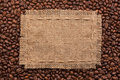 Frame of burlap and coffee beans lying on a white background Royalty Free Stock Photo