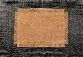 Frame of burlap, lies on a background of black leather