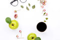 Frame with cup coffee apple glasses and dry rose flowers of black green leaf top view flat lay Royalty Free Stock Photo