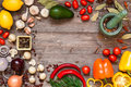 Frame of different fresh organic vegetables and spices on wooden table. Healthy natural food background with copy space. Royalty Free Stock Photo