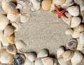Frame do Seashell na areia Fotografia de Stock Royalty Free