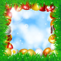 Frame of easter eggs made with various colors and patterns and fresh green grass on blue sky with white Stock Image