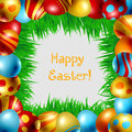 Frame of easter eggs made with various colors and patterns and fresh green grass on white background Royalty Free Stock Photography