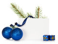 Frame from fir tree branch and chrismas toys the two bright christmas small gift boxes serpentine the empty card isolated on white Stock Images
