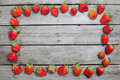 Frame of fresh red strawberries on wooden tabletop with copy space Royalty Free Stock Photo