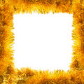 Frame of golden tinsel square garlands over white Stock Images