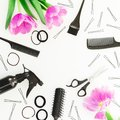 Frame with hairdresser tools - spray, scissors, combs, barrette and tulips flowers on white background. Beauty concept. Flat lay, Royalty Free Stock Photo