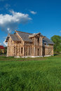A frame house on a grass meadow Royalty Free Stock Photo