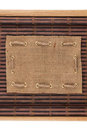 Frame made of burlap lying on a bamboo mat in the form of manuscript Royalty Free Stock Photo
