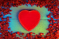 Frame made of red currant and cherry with red heart shape Royalty Free Stock Photo