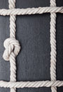 Frame made of rope on a wooden background Stock Photos