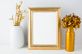 Frame mockup with golden decor poster styled portrait product design empty Stock Photography