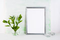 Frame mockup on light green background