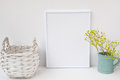 Frame mockup, wicker basket, pitcher with flowers on white background, styled image for product marketing Royalty Free Stock Photo