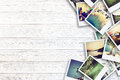Frame with old paper and photos on wooden background. Royalty Free Stock Photo