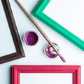 Frame, painbrushe and acrilic paint. Royalty Free Stock Images