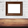 Frame picture on white brick wall and wood table background Royalty Free Stock Photo