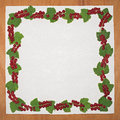 Frame with red currant berries and leaves on a wooden board Royalty Free Stock Photo