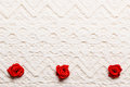 Frame of red silk roses on lace valentines day wedding invitation or greeting card decorative satin rose flowers white cloth Stock Photos