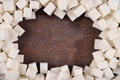 Frame of refined sugar on a wooden background Stock Image