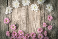 Frame of white and pink flowers on the wooden background horizontal Royalty Free Stock Photo