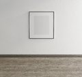 Framed art on wall of an art gallery canvas with wood floor Stock Photo