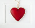Framed red heart with pearls glass shaped container string of cultured isolated on white background Royalty Free Stock Images