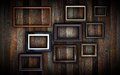 Frames on dark wooden wall Royalty Free Stock Photo